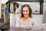 Pretty blonde reading the newspaper