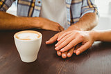 Couple enjoying a coffee holding hands