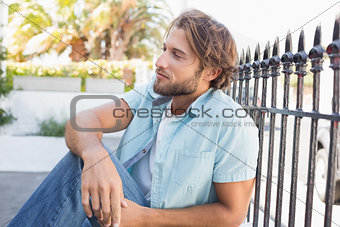 Casual man sitting and thinking