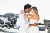 Gorgeous couple embracing at the coast