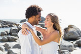 Gorgeous couple embracing by the coast