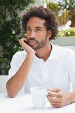 Thoughtful man having a coffee