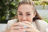 Beautiful businesswoman having a coffee