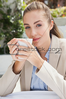 Beautiful businesswoman enjoying a coffee