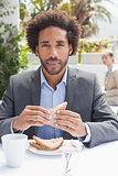 Businessman having sandwich for lunch