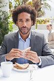 Businessman having sandwich for lunch