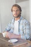 Casual man having a coffee