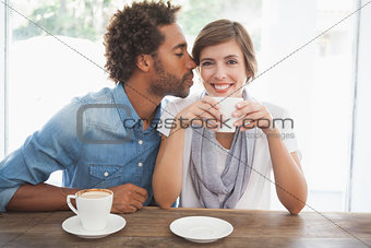 Casual couple having coffee together