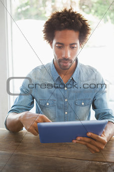 Casual man using his tablet
