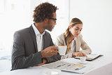 Business people having coffee looking at newspaper