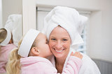 Cute little girl with mother in bathrobes