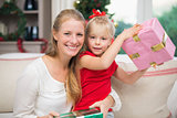Cute daughter and mother celebrating christmas