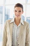 Pretty businesswoman smiling at camera