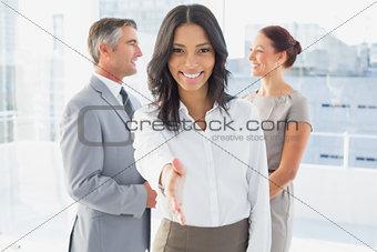 Businesswoman offering a friendly handshake