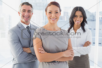 Businesswoman smiling with folded arms