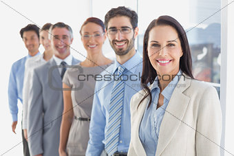 Smiling employee's in a line