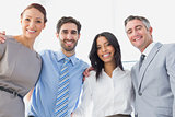Smiling employee's standing all together