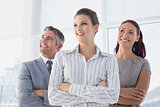 Smiling businesswoman and her colleagues