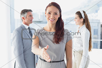 Smiling business woman offering handshake