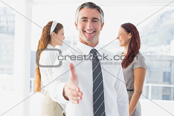 Smiling businessman offering a handshake