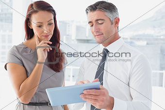 Business people comparing work notes