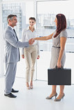 Businessman shaking co-workers hand
