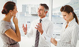 Businessman discussing work with co-workers