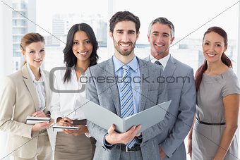 Business team reading from files