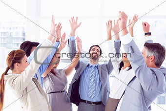 Business team raising their hands