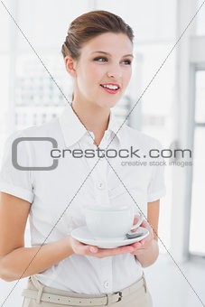 Business woman holding a cup