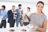 Businesswoman pouring herself some coffee
