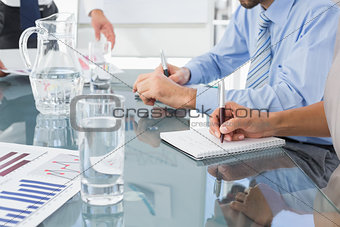 Business team writing some notes