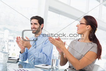 Business people applauding at meeting