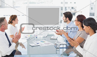 Business colleagues watching video presentation