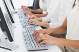 Employee's typing on their computers