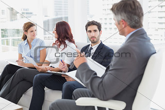 Business team discussing work notes