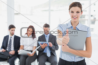 Business woman offering a handshake