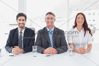 Smiling business people sitting together