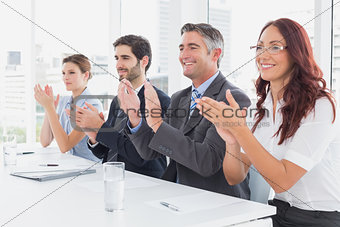 Business team all applauding