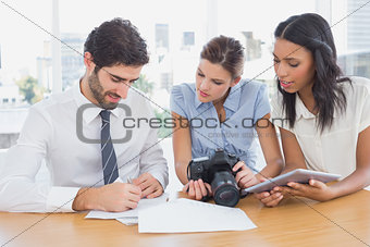 Business people using a camera