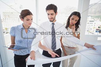 Business team reading a plan