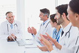 Doctors applauding a fellow doctor
