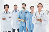 Serious doctors all standing together