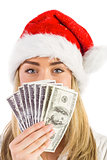 Festive blonde holding fan of dollars