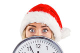 Festive blonde showing a clock