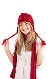 Pretty blonde smiling at camera in warm clothes