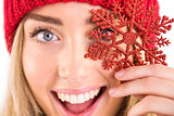 Happy blonde holding red snowflake