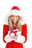 Sexy santa girl holding gift