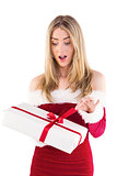 Pretty santa girl opening gift
