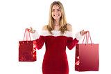 Pretty santa girl holding gift bags